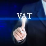 Businessman holding a white sign with the message VAT. Can be used for your advertising.